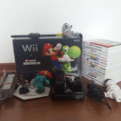 venda Nintendo Wii preto usado com 16 jogos e acessórios